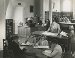 Students in Alumni Memorial Library Reading Room, 1950s