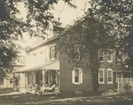 Women Seated on the Porch of South Hall (Trinity Cottage), Circa 1930